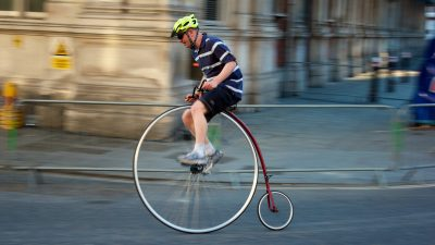 Image: Man riding in a penny farthing race
