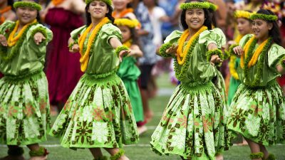 Image: Young hula dancers in traditional dress at competition