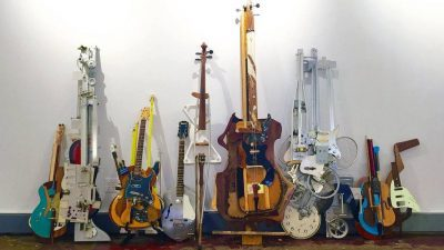 Image: Ken Butler's trash instruments leaning against the wall