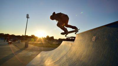 Image: skater hits halfpipe