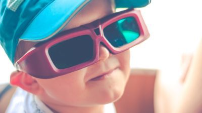 a child wearing virtual reality glasses