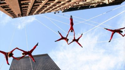 Image: bandaloop dancers on the side of a building