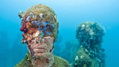 Image: One of Jason deCaires Taylor's underwater sculptures covered in coral