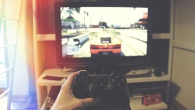 Image: Person holding a video game controller