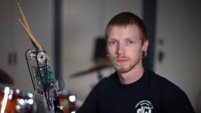 Image: Drummer Jason Barnes with his robotic drumming hand