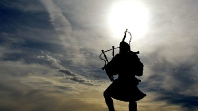 Image: Bagpiper in silhouette