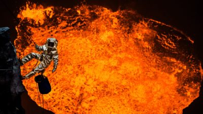 Image: Scientist in a heat proof suit climbing down into a volcano