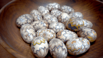 Image: a bowl of painted wooden eggs