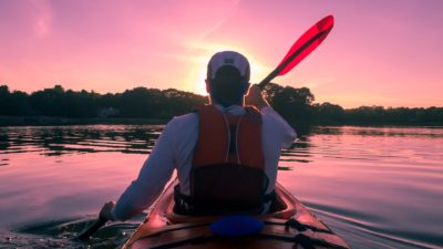Image: kayaker paddling into the sunset